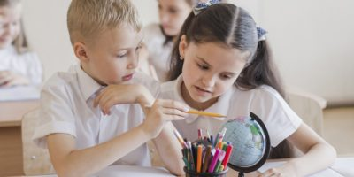 pupils-looking-globe-together_23-2147848804